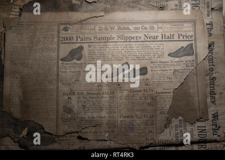 Shoe advertisement in old newspaper in 1920's. - Stock Photo
