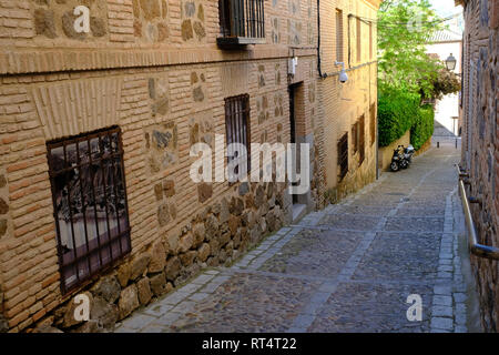typical alleyway in Toledo, Castilla la Mancha, Spain - Stock Photo