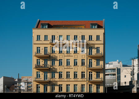 restored facade of typical old residential building  in Berlin - Stock Photo