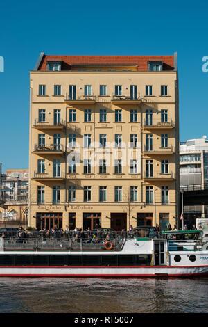 Berlin, Germany - february 2019: A typical berliner residential building facade near Friedrichstr. in Berlin, Mitte - Stock Photo