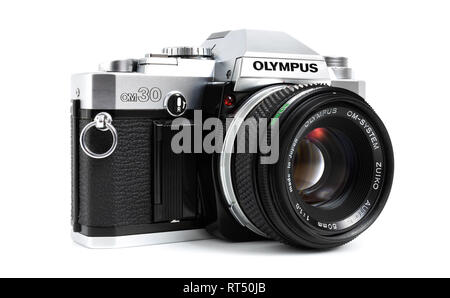 Prague, CZECH REPUBLIC - FEBRUARY 21, 2019: Olympus OM-30 a 35mm film SLR camera, launched by Olympus Corporation, laid on white background - Stock Photo