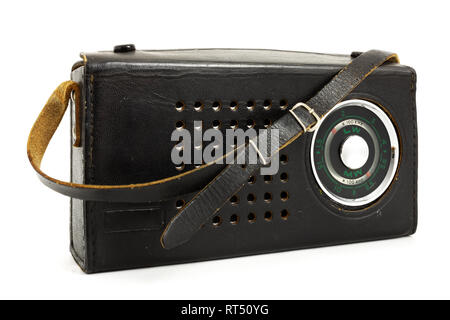 Old portable retro radio in leather cover laid on white background - Stock Photo