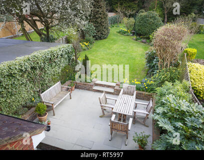 Overhead view of a typical suburban garden with patio furniture in Pinner, London, UK - Stock Photo