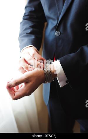 wedding details - elegant groom dressed wedding tuxedo costume - Stock Photo