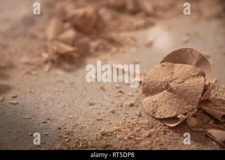 Circled wood sawdust closeup. Sawdust floor texture. Milling machine. Sawdust texture, background of brown sawdust - Stock Photo