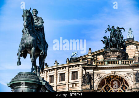 Germany, Dresden, Semperoper, Saxon State Opera at Theatre Square  with John of Saxony Memorial - Stock Photo
