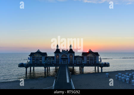 Germany, Mecklenburg-Western Pomerania, Ruegen, Sellin, view to sea bridge at sunset