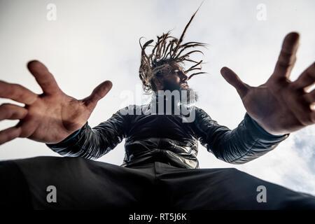 Bearded man with dreadlocks posing - Stock Photo
