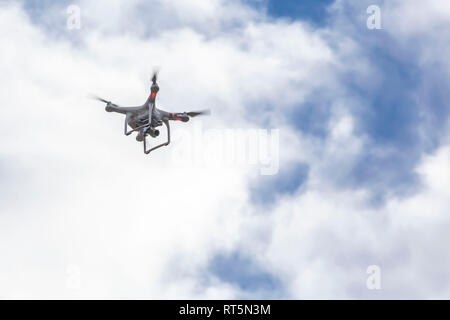 Drone flying in the sky - Stock Photo