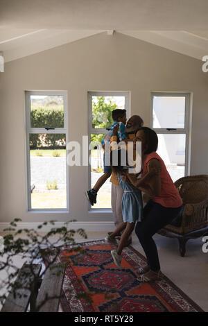 Multi-generation family having fun in living room - Stock Photo