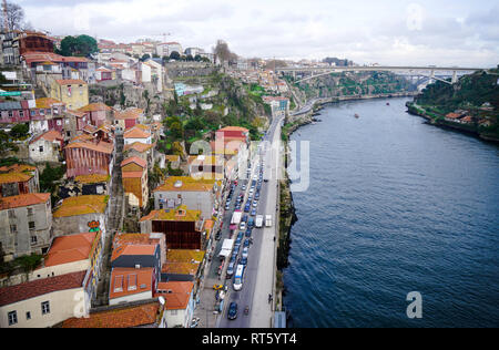 Porto, Portugal - December 2018: View from Luis I Bridge to Avenida Gustavo Eiffel with traffic jam and the Douro River. - Stock Photo