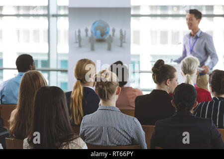 Group of business people attending seminar - Stock Photo