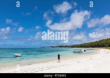 Mauritius, Indian Ocean, Flacq, East Coast, female tourist at beach of Belle Mare - Stock Photo