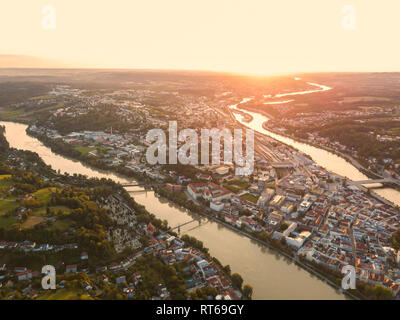 Germany, Bavaria, Passau, City of three rivers, Aerial view, Danube and Inn river, Veste Oberhaus and Maria Hilf at sunset - Stock Photo