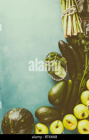 Organic  green fruit and veggie wallpaper over a blue board, top view,flat lay, copyspace left. - Stock Photo