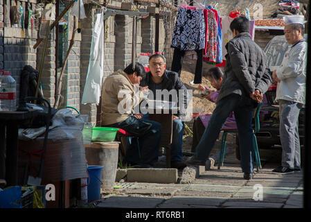 Asia, China, Beijing, people eating - Stock Photo