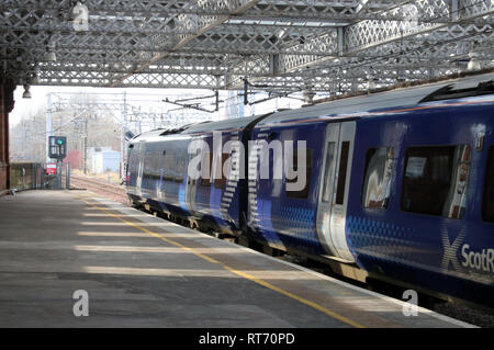 Class 380 Desiro electric multiple unit train in Arbellio Scotrail livery leaving Paisley Gilmour Street railway station on 25th February 2019. - Stock Photo