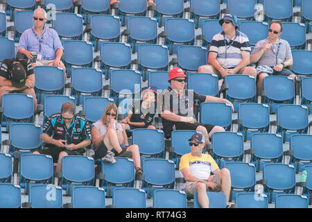 Adelaide, Australia. 28th Feb, 2019. Motorsport enthusiasts sitting in the grandstand in the shade on Day One of the Superloop Adelaide 500 Supercars championships  in Victoria Park Adelaide in sweltering temperatures forecast to reach 40 degrees celsius and is expected to attract large crowds of 270,000 visitors over four days Credit: amer ghazzal/Alamy Live News - Stock Photo
