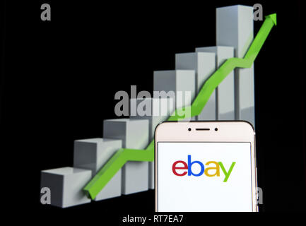 Hong Kong. 10th Feb, 2019. American multinational e-commerce online auction and shopping company Ebay logo is seen on an android mobile device with an ascent growth chart in the background. Credit: Miguel Candela/SOPA Images/ZUMA Wire/Alamy Live News - Stock Photo