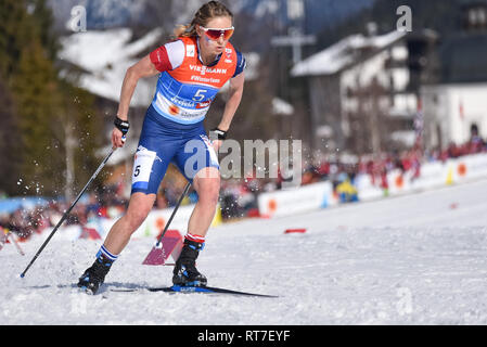 Seefeld, Austria, 28th February, 2019. How hot was it? Jessie Diggins, cut the legs off her racing uniform to race the anchor leg for the US Ski Team's relay team at nordic world ski championships.  Temperatures were in the 50s. The US finished fifth. © John Lazenby/Alamy Live News. - Stock Photo
