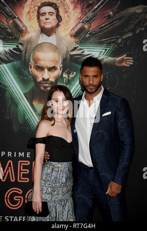 28 February 2019, Bavaria, München: British actor Ricky Whittle and Australian actress Emily Browning are on the red carpet for the film American Gods - Season 2 at Gloria Palace. The sequel to the 'American Gods' series will be available on Amazon Prime Video from 11 March. Photo: Felix Hörhager/dpa Stock Photo