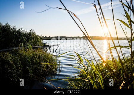 Germany, Mecklenburg-Western Pomerania, Ruegen, Sellin, jetty at sunset