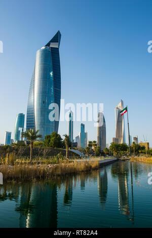 Arabia, Kuwait, Kuwait city, Al Hamra tower and Al Shaheed Park - Stock Photo