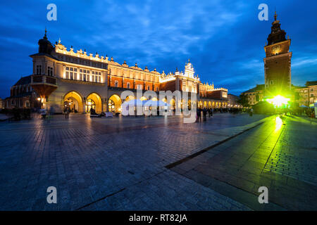 Poland, Krakow, city by night, Main Square in the Old Town, Cloth Hall and Town Hall Tower - Stock Photo