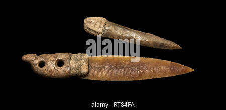 Brown obsidian dagger with a bone handle carved into the shape of a snake. It is believed this may have been a ritual dagger. Catalhoyuk Collections.  - Stock Photo