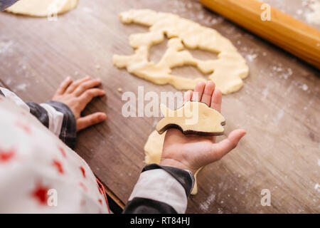 Boy cutting out cookies, close-up - Stock Photo