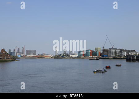 Buildings, including the Optic Cloak, create an urban skyline along the River Thames in London, as seen from Greenwich, United Kingdom. - Stock Photo