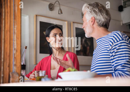 Mature couple meeting in a cafe - Stock Photo