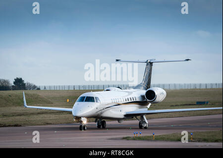 Embraer Legacy 650 G-WIRG business jet aircraft of Air Charter Scotland taxiing at Luton airport, England. - Stock Photo