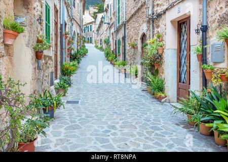 VALDEMOSSA, SPAIN - JANUARY 28, 2019: The old aisles of Valldemossa village. - Stock Photo