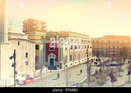 Tirana, Albania. February 2019: Newly reconstructed city central Skanderbeg square, citizens walking at pedestrian zone - Stock Photo