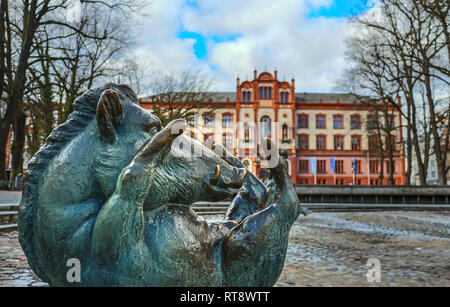 happy wild boar statue in front of university rostock germany - Stock Photo