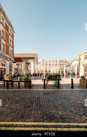 LONDON, UK, February 25, 2019: Covent Garden with Saint Paul' s church and Henrietta Street - Stock Photo