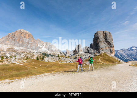 Italy, Cortina d'Ampezzo, two people hiking in the Dolomites mountain area - Stock Photo