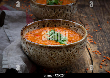 Red lentil soup with paprika, ginger and coconut milk and coriander - Stock Photo