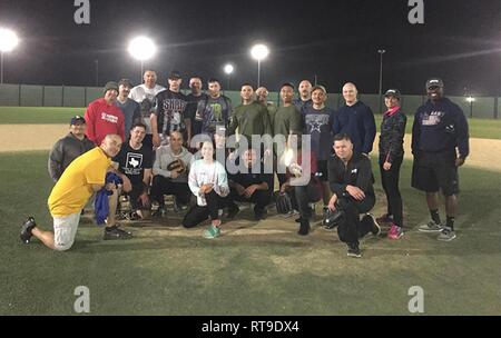 Blackhorse Soldiers of the 300th Sustainment Brigade and Mustang Soldiers of the Special Troops Battalion, 300th Sustainment Brigade, together after a head to head softball game at Camp Arifjan, Kuwait, Jan. 27, 2019 - Stock Photo