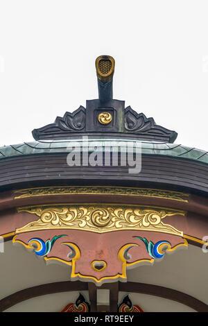 Setagaya, Tokyo, Japan - August 19, 2017: Haiden (worship hall) of Kitazawa Hachiman Jinja. Roof Toribusuma and Kazari-Kanagu (Metal ornaments) detail - Stock Photo