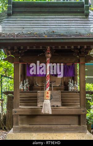 Setagaya, Tokyo, Japan - August 19, 2017: Noyashiki Inari Sha, Small shinto shrine located inside Kitazawa Hachiman Jinja shrine complex. - Stock Photo