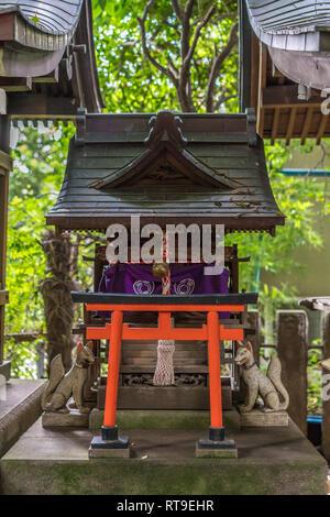 Setagaya, Tokyo, Japan - August 19, 2017: Atago Inari Sha.  Small shinto shrine located inside Kitazawa Hachiman Jinja shrine complex. - Stock Photo