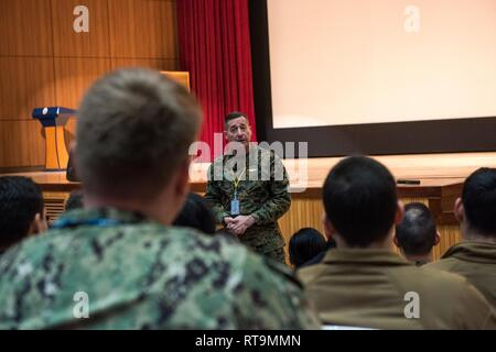 BUSAN, Republic of Korea (Jan. 31, 2019) U.S. Marine Corps Sgt. Maj. Anthony A. Spadaro, senior enlisted leader of U.S. Indo-Pacific Command, speaks with Sailors assigned to Commander, U.S. Naval Forces Korea (CNFK) during an all-hands call at Commander, Republic of Korea (ROK) Fleet headquarters. Spadaro's visit included all-hands calls with service members on the peninsula as well as engagements with key senior enlisted U.S. and ROK military members. - Stock Photo