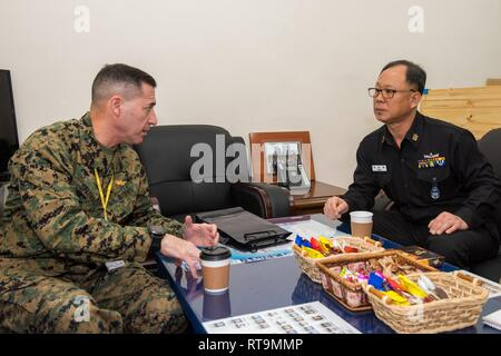 BUSAN, Republic of Korea (Jan. 31, 2019) U.S. Marine Corps Sgt. Maj. Anthony A. Spadaro, senior enlisted leader of U.S. Indo-Pacific Command, speaks with Republic of Korea (ROK) Navy Master Chief Park, Hee Bok, fleet master chief of Commander, Republic Of Korea Fleet (COMROKFLT), during an office call at COMROKFLT headquarters. Spadaro's visit included all-hands calls with service members on the peninsula as well as engagements with key senior enlisted U.S. and ROK military members. - Stock Photo