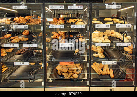 Industrial self-service bakery bread, junk food, displayed on a supermarket - Stock Photo