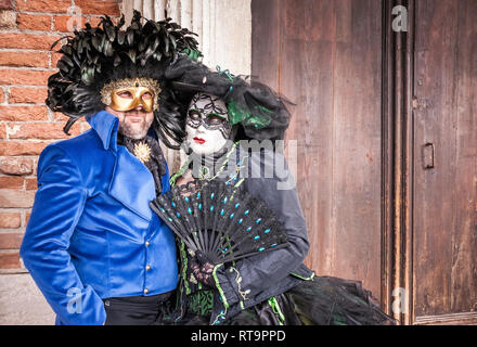 Couple of masks during the Venice (Italy) carnival - Stock Photo