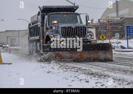 Tech. Sgt. Jason Nelson of the 171st Air Refueling Wing, Civil Engineer Squadron plows the snow to clear the roads during this mornings snowfall near Pittsburgh, Feb. 1, 2019. Nelson spent most of his morning making sure all commercial vehicles had clear, safe roads to travel on. - Stock Photo