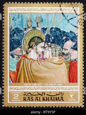 RAS AL-KHAIMAH - CIRCA 1970: a stamp printed in the Ras al-Khaimah shows The Kiss of Judas, Painting by Giotto di Bondone, Life of Jesus Christ, circa - Stock Photo