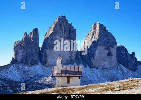 The north face of Tre Cime di Lavaredo  and the chapel on Forcella Lavaredo, Misurina, Dolomites, Veneto, Italy - Stock Photo
